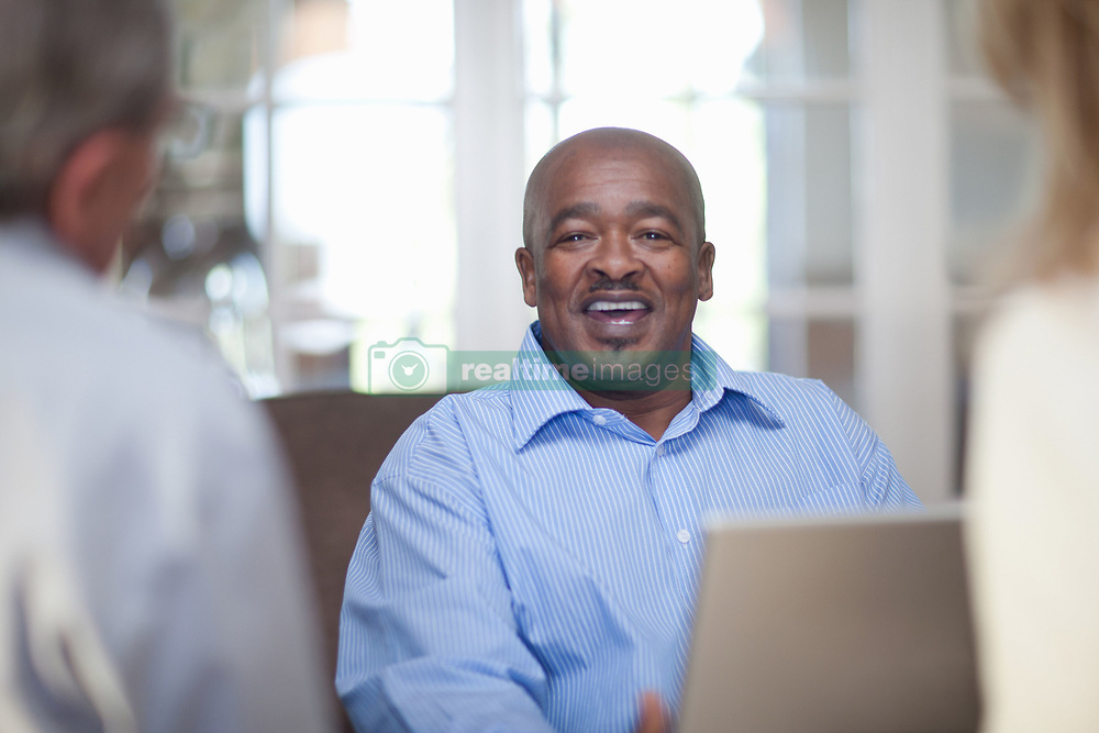 Older friends talking in living room (Credit Image: © Image Source/Albert Van Rosendaa/Image Source/ZUMAPRESS.com)