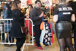 © Licensed to London News Pictures. 08/11/2018. London, UK. Customers with items inside the HM store in Oxford Circus buying the Jeremy Scott H&M X Moschino collection.<br /> Photo credit: Ray Tang/LNP