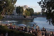 Paris seine river quay . people gathering at sunset on right bank quays. Urban beach on the Seine river quays  Paris  France   / bain de soleil sur les quais de la seine