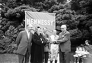 """15/07/1967<br /> 07/15/1967<br /> 15 July 1967<br /> Hennessy Handicap at Leopardstown Races, Leopardstown Racecourse, Co. Dublin.  Mr Maurice Hennessy, (right) Chairman of Jas. Hencessy and Co. Ltd. of France presenting the Hennessy Trophy to Mrs J.A.N. Glover, wife of Mr J.A.N. Glover of Moneymore, Co. Derry, owner of the winner """"My Kuda"""", of the Hennessy Handicap. Also in the  picture are (from left): Mr Fred Clarke, Manager of Leopardstown; Mr Aubrey Brabazon, trainer and T.P Burns, jockey."""