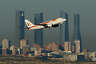 MADRID, SPAIN - SEPTEMBER 05: An Iberia airplane takes off in front of the Cuatro Torres (Four Towers) business area on September 5, 2014 in Madrid, Spain. Iberia, British Airway's partner in IAG, is on its way back to profits in 2014 after last years heavy losses for IAG (International Airlines Group). Iberia had to restructure the company, which claimed around 4,500 jobs. The Spanish airline is working on new strategies and expanding its low-cost subsidiary 'Iberia Express'. (Photo by Pablo Blazquez Dominguez/Getty Images)