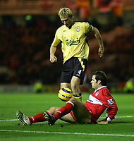 Fotball<br /> England 2004/2005<br /> Foto: SBI/Digitalsport<br /> NORWAY ONLY<br /> <br /> Middlesbrough v Liverpool<br /> Barclays Premiership, Riverside Stadium, Middlesbrough 20/11/2004.<br /> <br /> Middlesbrough's Mark Viduka (R) battles from the floor with Liverpool's Sami Hyypia (L).