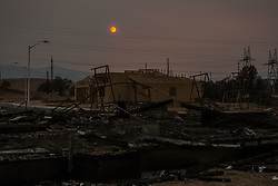August 1, 2018 - Redding, California, U.S - Wednesday, August 1, 2018.One home is lost and another new-build remains intact on the western edge of Redding, California, after the Carr Fire swept through the neighborhood recently. The Carr Fire, which began on July 23, has burned more than 115,000 acres, destroying more than 1,000 residential structures. (Credit Image: © Tracy Barbutes via ZUMA Wire)
