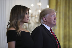 President Donald Trump and first lady Melania Trump listen as Andy Pollack (not pictured) speaks during a Hanukkah reception in the East Room of the White House on December 6, 2018 in Washington, DC. Andy's 18-year-old daughter Meadow Pollack was killed in the Stoneman Douglas High School shooting on February 14, 2018. (Photo by Oliver Contreras/SIPA USA)