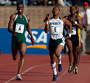 Derrick Jones of Long Beach Poly High (Calif.), right, and Reuben McCoy of Winslow (N.J.) battle on the homestretch of the Championship of America Boys 4 x 400-meter relay in the 110th Penn Relays at  Franklin Field on Saturday, April 24, 2004 in Philadelphia. Winslow won in 3:13.71 and Poly was second in 3:14.18.