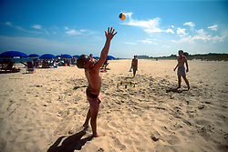 """Scott Cameron, right, and a group of friends play a game of """"spikeball,"""" Saturday, Aug. 17, 2019 at Henlopen Acres Beach Club in Rehoboth Beach, Del. (Photo by D. Ross Cameron)"""