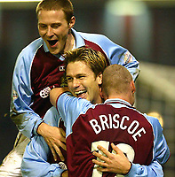 Photo Aidan Ellis.<br />Burnley v Fulham (FA Cup 5th Rd Replay) 26/02/03<br />Burnley scorer Gareth taylor (middle) celebrates with team mates Lee Bricoe and Ian Moore