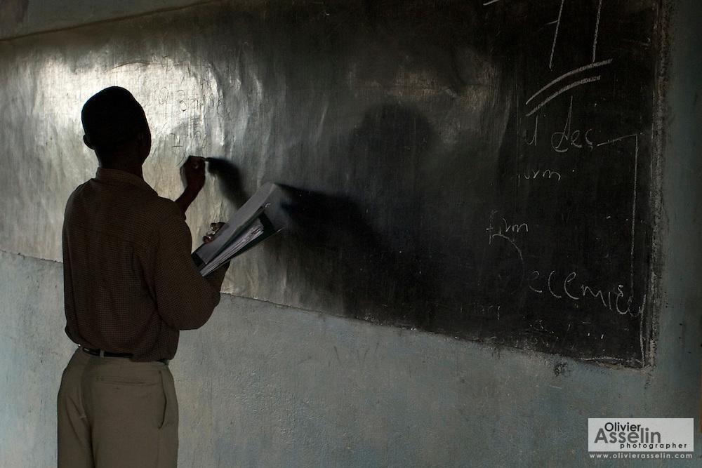 Teacher in classroom at Buduburam refugee camp, 35 km west of Accra, Ghana.