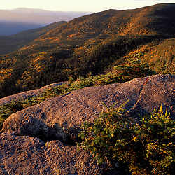 Deciduous Forest.  The colors of early fall are present in this scene of NH's Franconia Notch S.P.  North Kinsman Mtn., NH