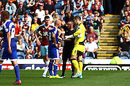 Alan McCormack of Brentford receives a yellow card from referee David Webb . Skybet football league championship match, Burnley  v Brentford at Turf Moor in Burnley, Lancs on Saturday 22nd August 2015.<br /> pic by Chris Stading, Andrew Orchard sports photography.