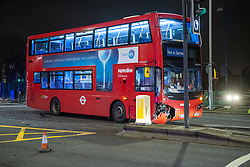 © Licensed to London News Pictures. 30/01/2021. London, UK. A damaged bus on the A40. A road traffic collision between a car and a bus closed the busy A40 at the junction of Wales Farm Road in Acton, the collision occurred at approximately 22:30GMT. Photo credit: Peter Manning/LNP