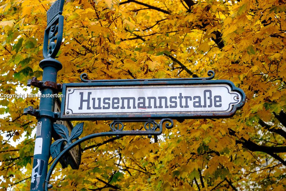 Ornate old street sign at Husemannstrasse in bohemian Prenzlauer Berg during Autumn in Berlin Germany