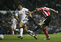 Photo: Paul Thomas.<br /> Leeds United v Sunderland. Coca Cola Championship. 13/09/2006.<br /> <br /> Daryl Murphy (R) of Sunderland fires another shot at goal past Paul Butler.