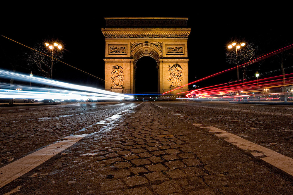 The Arc de Triomphe (Arc de Triomphe de l'Étoile) is one of the most famous monuments in Paris. It stands in the centre of the Place Charles de Gaulle, at the western end of the Champs-Élysées. The Arc de Triomphe honours those who fought and died for France in the French Revolutionary and the Napoleonic Wars, with the names of all French victories and generals inscribed on its inner and outer surfaces. Beneath its vault lies the Tomb of the Unknown Soldier from World War I. The monument stands 50 metres (164 ft) in height, 45 m (148 ft) wide and 22 m (72 ft) deep. It is the second largest triumphal arch in existence (after Arch of Triumph in Pyongyang). Its design was inspired by the Roman Arch of Titus.