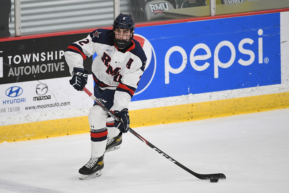 PITTSBURGH, PA - MARCH 13: Brendon Michaelian #2 of the Robert Morris Colonials skates with the puck in the first period during Game Two of the Atlantic Hockey Quarterfinal series against the Niagara Purple Eagles at Clearview Arena on March 13, 2021 in Pittsburgh, Pennsylvania. (Photo by Justin Berl/Robert Morris Athletics)