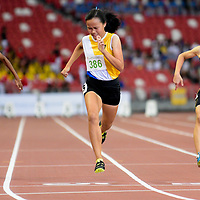 Jade Chew (#386) of Nanyang Girls' High School clinches first place in the C Division girls' 100m final with a timing of 12.86s. (Photo © Eileen Chew/Red Sports)