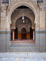 FEZ, MOROCCO - CIRCA MAY 2018:  Courtyard of the Al-Attarine Madrasa in Fez. The courtyard of this small Marinid madrasa is a dazzling example of intricate Islamic architecture.