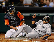 Sep 27, 2013; Houston, TX, USA; New York Yankees second baseman Robinson Cano (24) beats the throw to Houston Astros catcher Carlos Corporan (22) during the fourth inning at Minute Maid Park. Mandatory Credit: Thomas Campbell-USA TODAY Sports