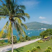 Road along the sea on Promthep Cape with Nai Harn beach on the horizon, Phuket