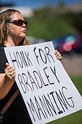 """06 JUNE 2012 - PHOENIX, AZ:   LIISA WALE pickets a street corner in Phoenix Wednesday in support of US Army PFC Bradley Manning. About 10 people gathered on a street corner in central Phoenix Wednesday to support Manning, who been criminally charged for passing secrets in the """"wikileaks"""" case and is awaiting trial in a US Army jail.       PHOTO BY JACK KURTZ"""