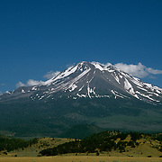 """Mount Shasta in Northern California  at 14,179 feet (4,322 m) is the second highest peak in the Cascades and the fifth highest in California. Mount Shasta has an estimated volume of 85 cubic miles (350 km3) which makes it the most voluminous stratovolcano in the Cascade Volcanic Arc.  Theodore Roosevelt said of the mountain,  """"When I first caught sight of it over the braided folds of the Sacramento Valley, I was fifty miles away and afoot, alone and weary. Yet all my blood turned to wine, and I have not been weary since."""""""