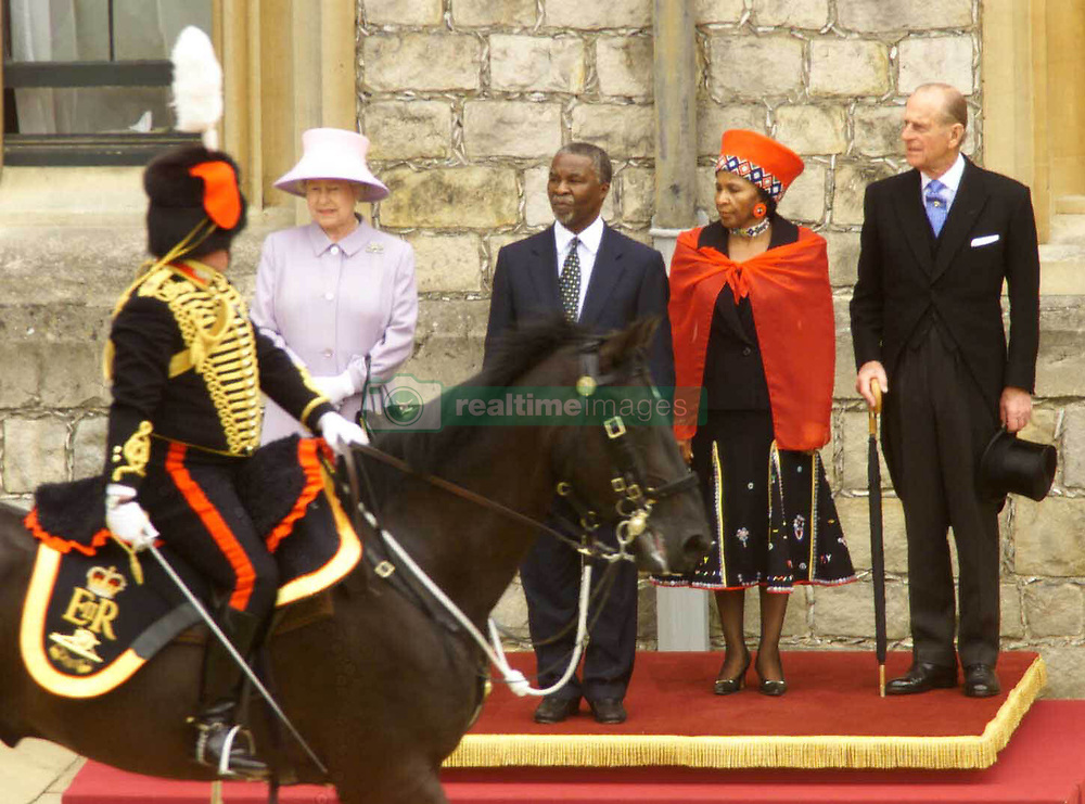 President and Mrs Mbeki of South Africa with Britain's Queen Elizabeth II and the Duke of Edinburgh during the state arrival ceremony at Windsor Castle. Mounted division of the Lifeguards, Blues and Royals and The Kings Troop Royal Horse Artillery.