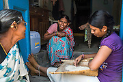 Neighbours (L-R) Charpathi Anasurya, 65, Indira Kakkerla, 40, and Monika Kakkerla, 22, chat at their front door in Peddapur, a remote village in Warangal, Telangana, India, on 22nd March 2015. Safe Water Network works with local communities that live beyond the water pipeline to establish sustainable and reliable water treatment stations within their villages to provide potable and safe water to the communities at a nominal cost. Photo by Suzanne Lee/Panos Pictures for Safe Water Network