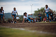 SAN MARTIN DE LAS PIRAMIDES, MEXICO - APRIL 15, 2017: Lizeth Garcia hits with her hips a rubber ball during a tourney of Mesoamerican Ball Game titled Ulamaztli. A player prepares himself to receive and hit a rubber ball during a tourney of Mesoamerican Ball Game titled Ulamaztli. To withstand the blow of the ball, that weighs 7 pounds, the players protect their hips with bandages and leather belts. Each team has 5 players and the game purpose is to keep the ball inside the play area without touch it with hands or another part of the body, except the hips. Rodrigo Cruz for The New York Times