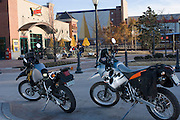 Dual sport motorcycles parked in front of Sonic headquarters in downtown Oklahoma City Bricktown.