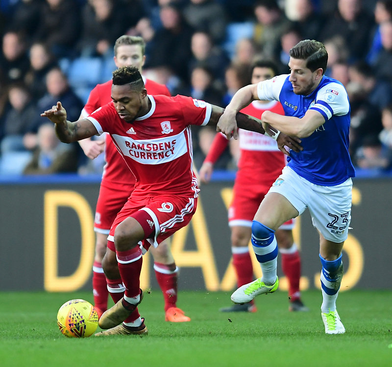 Middlesbrough's Britt Assombalonga vies for possession with Sheffield Wednesday's Sam Hutchinson<br /> <br /> Photographer Chris Vaughan/CameraSport<br /> <br /> The EFL Sky Bet Championship - Sheffield Wednesday v Middlesbrough - Saturday 23rd December 2017 - Hillsborough - Sheffield<br /> <br /> World Copyright © 2017 CameraSport. All rights reserved. 43 Linden Ave. Countesthorpe. Leicester. England. LE8 5PG - Tel: +44 (0) 116 277 4147 - admin@camerasport.com - www.camerasport.com