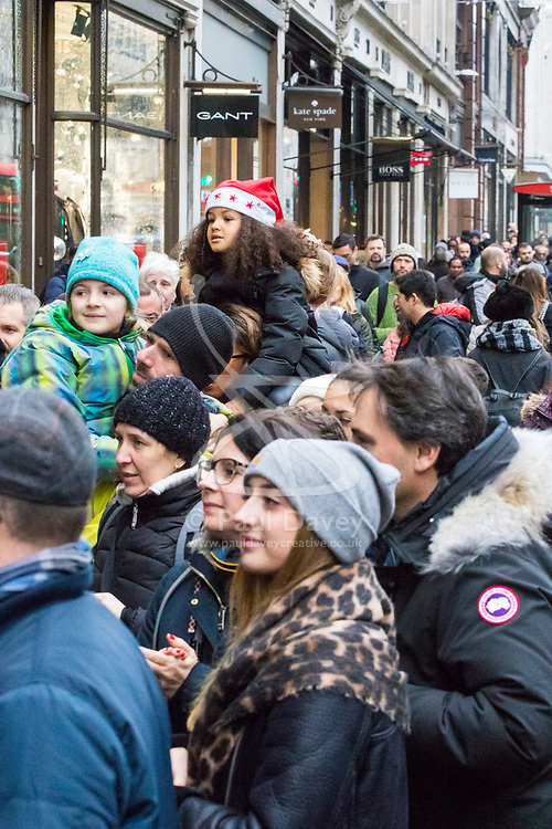 London, December 24 2017. Crowds grow in London's west end on Christmas eve as last minute shoppers hunt for gifts. PICTURED: Hundreds of customers create queue of over 50 yards in each direction on Regent Street as they wait for Hamley's Toy Store to open at midday. © SWNS