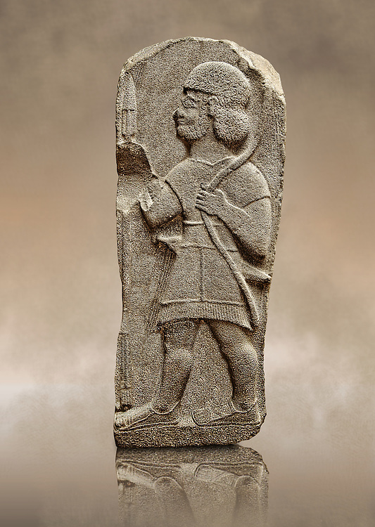Late Hittite Basalt funereal Steel with a relief sculpture of a warrior from 9 - 8th Cent B.C, excavated from Arslan Tash (Turkish; Arslan Lion, Taş Stone), ancient Hadātu, is an archaeological site in northern Syria 30km east of the Euphrates River and nearby the town of Ain al-Arab. Istanbul Archaeological Museum Inv. No 1981. .<br /> <br /> If you prefer to buy from our ALAMY STOCK LIBRARY page at https://www.alamy.com/portfolio/paul-williams-funkystock/hittite-art-antiquities.html - Type - Hadatu  l - into the LOWER SEARCH WITHIN GALLERY box. Refine search by adding background colour, place, museum etc<br /> <br /> Visit our HITTITE PHOTO COLLECTIONS for more photos to download or buy as wall art prints https://funkystock.photoshelter.com/gallery-collection/The-Hittites-Art-Artefacts-Antiquities-Historic-Sites-Pictures-Images-of/C0000NUBSMhSc3Oo