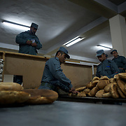 November 14, 2012 - Kabul, Afghanistan: Afghan National Police (ANP) cadets prepare breakfast bread at the canteen in the Afghan Nacional Police Academy...ANP Academy trains 1250 cadets at the time during a period of four years. Every year, five hundred new recruits are selected, out of more than nine thousand of candidates, to join the academy and other five hundred graduate. Fifteen per cent of the recruits are women. (Paulo Nunes dos Santos/Polaris)