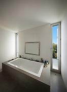 modern house, nice bathtub in a bathroom with window
