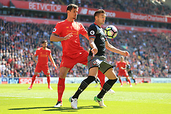 7th May 2017 - Premier League - Liverpool v Southampton - Dejan Lovren of Liverpool battles with Dusan Tadic of Southampton - Photo: Simon Stacpoole / Offside.
