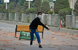May 9, 2017 - India - Youth clash with Indian police in Srinagar Kashmir on May 09, 2017. Indian police used teargas shells, chili smoke and stun grenades to disperse them. The agitating students were protesting against the Indian police raid last April in Pulwama college which left more than fifty students injured in police action. (Credit Image: © Faisal Khan/Pacific Press via ZUMA Wire)