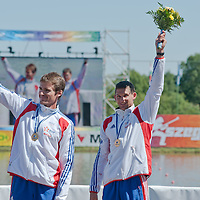 Jouve Sebastien (L) and Hybois Arnaud (R) from France celebrate their victory in the K2 men Kayak 200m final of the 2011 ICF World Canoe Sprint Championships held in Szeged, Hungary on August 21, 2011. ATTILA VOLGYI