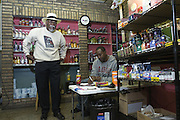 Author Norris Shelton speaks with employee Howard Bedford (not shown) and Dereck Barber while checking in at Mr. Silk's Liquors at 2100 West Muhammad Ali Boulevard, Tuesday Sept. 26, 2011 in Louisville, Ky. (Photo by Brian Bohannon)