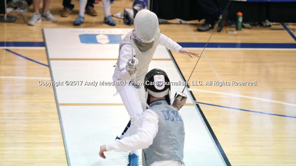 11 February 2017: UNC's Ian Head (above) and Duke's Will Feldman (below) during Foil. The Duke University Blue Devils hosted the University of North Carolina Tar Heels at Card Gym in Durham, North Carolina in a 2017 College Men's Fencing match. Duke won the dual match 19-8 overall, 6-3 Foil, 6-3 Epee, and 7-2 Saber.
