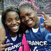 09 August 2012: France Endeme Miyem and Isabelle Yacoubou pose as the celebrate after the 81-64 Team France victory over Team Russia, during the women's basketball semi-finals, at the 02 Arena, in London, Great Britain.