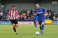 AFC Wimbledon midfielder Mitchell (Mitch) Pinnock (11) dribbling during the Pre-Season Friendly match between AFC Wimbledon and Brentford at the Cherry Red Records Stadium, Kingston, England on 5 July 2019.