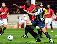 Photo: Dave Linney.<br />Walsall v West Bromwich Albion. Pre Season friendly. 15/07/2006Walsall's .Hector Sam (L) shrugs of the challenge from West Brom's  Chris Parry