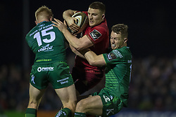 January 6, 2019 - Galway, Ireland - Andrew Conway of Munster tackled by Darragh Leader and Matt Healy of Connacht during the Guinness PRO14 match between Connacht Rugby and Munster Rugby at the Sportsground in Galway, Ireland on January 5, 2019  (Credit Image: © Andrew Surma/NurPhoto via ZUMA Press)