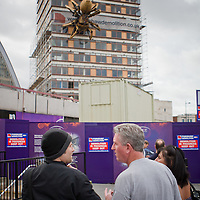 Liverpool wakes up to find a giant spider has appeared on the side of Concourse House by Lime Street Station. These guys were discussing the appearance of the spider.