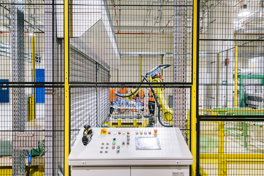 CATANIA, ITALY - 13 APRIL 2018: A control station of the production line of the the new bifacial thin film solar panel  is seen here during the testing phase at the  3Sun factory, the last European photovoltaic factory in Catania, Italy, on April 13th 2018.<br /> <br /> 3SUN is the last European photovoltaic factory which intends to compete with the most important worldwide companies in this sector. 3SUN is an industrial project that was founded in 2010 as a joint venture agreement between Enel Green Power, Sharp Corporation and STMicroelectronics. Since 2015 3Sun is entirely owned by Enel Green Power, the Italian multinational renewable-energy corporation.<br /> <br /> <br /> The 3SUN solar factory will produce bifacial thin film solar panel using heterojunction technology.<br /> The new panel marks a technological leap forward from the previous solution, based on the multi-junction of thin film silicon, to the production of new, cutting-edge bifacial photovoltaic modules using the heterojunction of amorphous and crystalline silicon (known as HJT).<br /> The new module will be exclusively produced in Catania and will guarantee a high performance in terms of efficiency and productivity, as well as a low degradation rate.