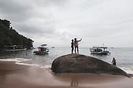 Paraty, Brazil - March 17, 2019: Two women take a selfie at Vermelha Beach in Paraty, Brazil.