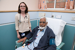 Doctor talking to a patient on the Nottingham City Hospital Renal Unit,