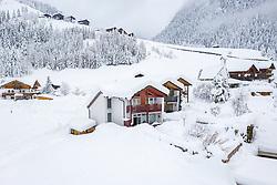 THEMENBILD - Tief verschneite Häuser im Ortsteil in Lesach, am Mittwoch den 9. Dezember 2020 in Kals. Luftbild mit einer Drohnen nach den starken Schneefällen welche vom 5. bis 8. Dezember 2020 für grosse Neuschneemengen in Oberkärnten und Osttirol sorgten // Deeply snowed houses in Lesach, on Wednesday December 9, 2020 in Kals. Photo taken with a drone after the heavy snowfalls which caused large amounts of new snow in Upper Carinthia and East Tyrol from December 5th to 8th, 2020. EXPA Pictures © 2020, PhotoCredit: EXPA/ Johann Groder