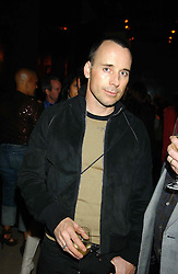 DAVID FURNISH at a party to celebrate the first 20 years of fashion label Donna Karan held at her store at 19/20 New Bond Street, London W1 on 21st September 2004.<br />