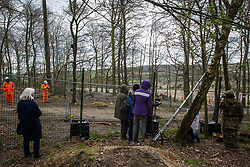 Wendover, UK. 9th April, 2021. Environmental activists document tree felling operations for the HS2 high-speed rail link in Jones Hill Wood, ancient woodland said to have inspired Roald Dahl. Tree felling work began this week, in spite of the presence of resting places and/or breeding sites for pipistrelle, barbastelle, noctule, brown long-eared and natterer's bats, following the issuing of a bat licence to HS2's contractors by Natural England on 30th March.